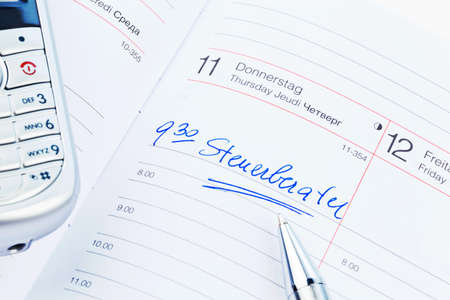 entered: a date is entered on a calendar  tax consultants Stock Photo