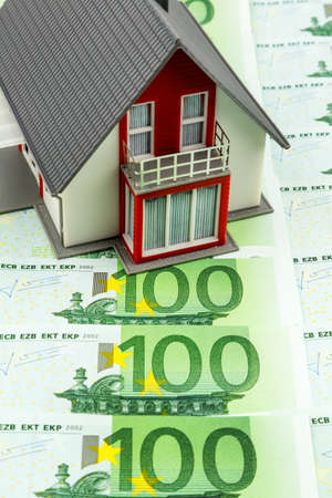 residential house on banknotes, symbolic photo for home purchase, financing, building society photo
