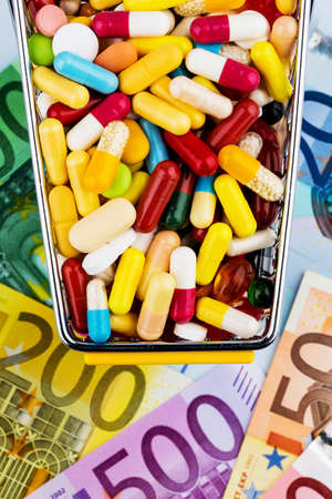 health industry: tablets, shopping cart, euro bills, symbolic photo for pharmaceuticals, health insurance, health care costs Stock Photo