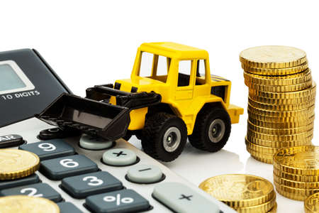 doldrums: cost accounting in the construction industry and the construction industry. higher higher prices in road construction and in residential construction. excavator with coins and calculator