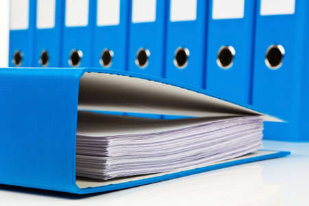 filing document: file folder with documents and documents. retention of contracts. Stock Photo
