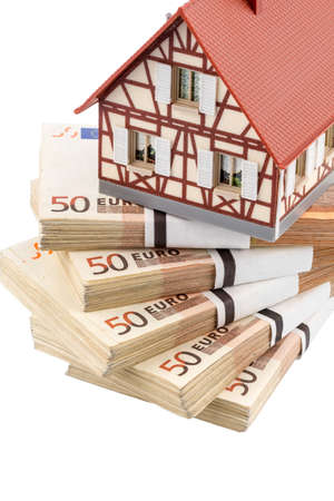 half-timbered house on euro banknotes, symbolic photo for home purchase, financing, building society photo