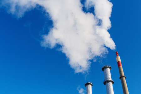 particulate: chimney of an industrial company with a strong smoke. symbolic photo for environmental protection and ozone. Stock Photo