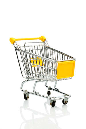 purchasing power: shopping cart against white background, symbol photo for consumption crisis and purchasing power Stock Photo