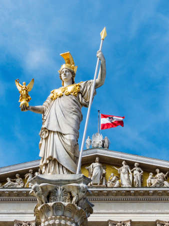 athene: the parliament in vienna, austria. with the statue of pallas athene the greek goddess of wisdom. Stock Photo