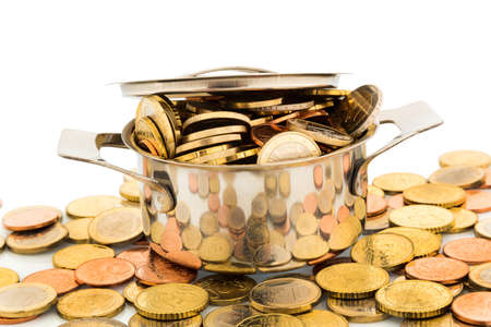 financially: a pressure cooker is filled with euro coins, symbolic photo for funding Stock Photo