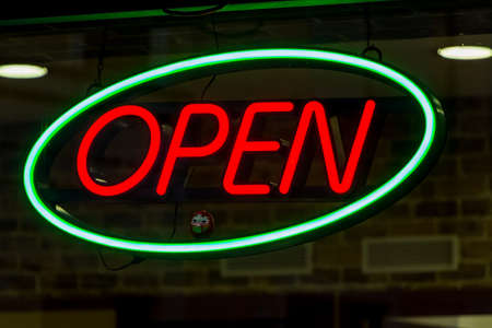 open sign shows the open business on photo