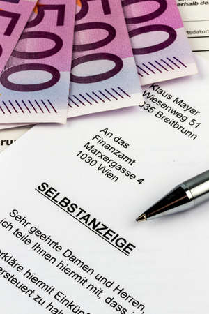 treaties: symbolic photo for a self display due to evasion of taxes by the tax office in austria Stock Photo