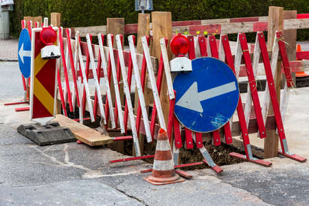 energy suppliers: construction site on a road. laying of pipes for lines of energy suppliers Stock Photo