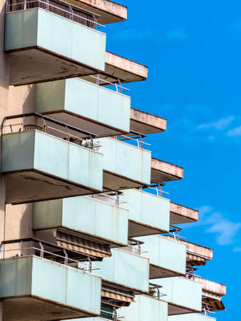 tristesse: balconies of a hotel building in a seaside resort