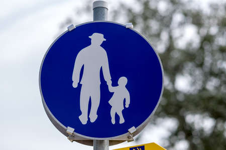 the sign walkway in austria with father and daughter photo