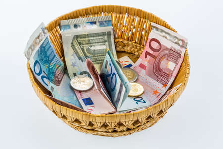 tax tips: a basket of money for donations and gratuities