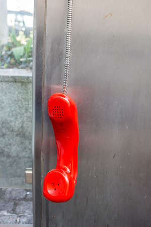cell phone booth: a phone booth in the telekom austria with red telephone handset