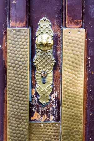 the door handle on the front door of an old residential building in the city Stock Photo - 27460435