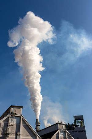 chimney: from a smoking chimneys smokes white smog
