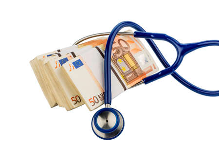 monetary policy: stethoscope and euro banknotes, symbolic photo for monetary union, stability and risks for the euro