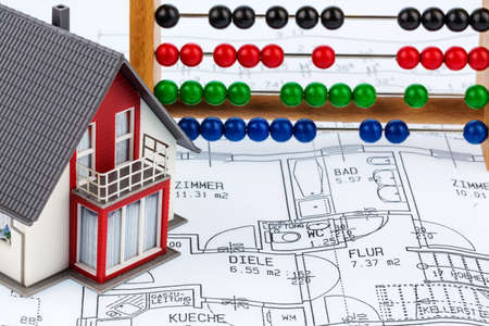house, abacus, plan, symbol photo for house construction, financing, building society photo