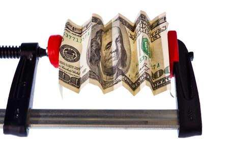 crisis economica: un billete de banco euro en el tornillo de banco. crisis económica y financiera. Foto de archivo