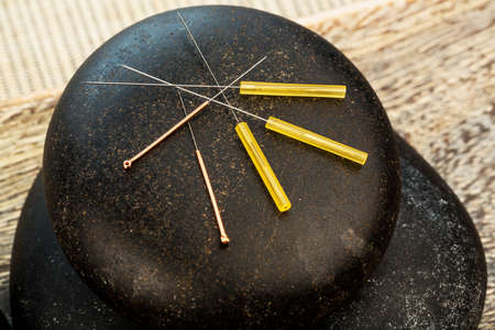 naturopaths: several needle for acupuncture are adjacent. traditional chinese medicine (alternative medicine).