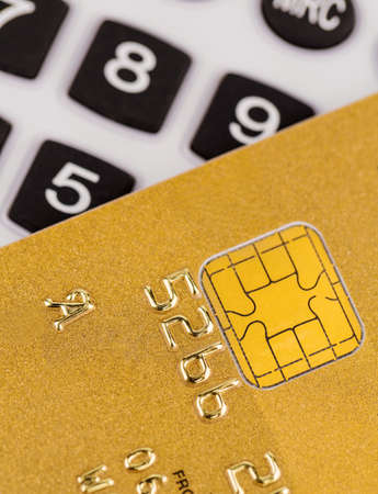 cashless: a gold credit card and a calculator. symbolic photo for cashless purchases and status symbols. Stock Photo