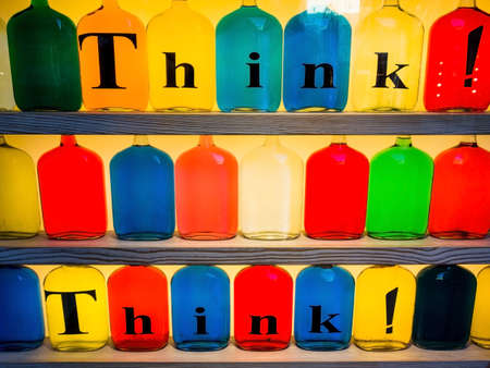reestablishment: in a shop window colored bottles with the inscription: think