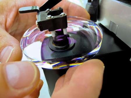in an optician. grinding a glass glasses Stock Photo