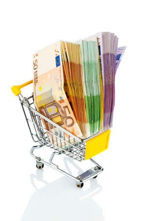 purchasing power: euro bank notes in a shopping cart icon photo for purchasing power, shopping, money printing and inflation