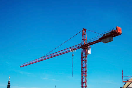 financed: a construction crane to carry loads on a building site Stock Photo