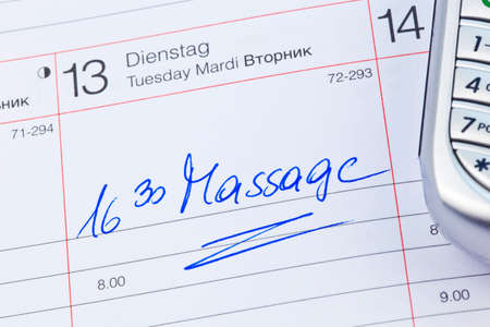 entered: a date is entered on a calendar: massage Stock Photo