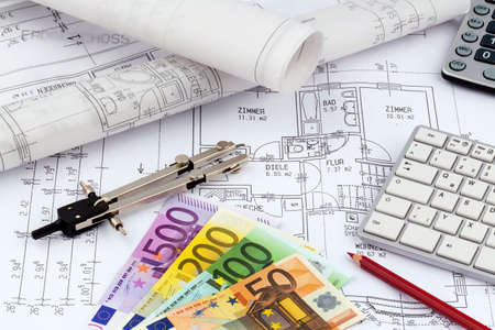 an architects blueprint with euro money. symbolic photo for funding and planning of a new house. photo