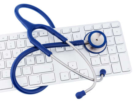 edv: stethoscope and keyboard of a computer, symbol photo for diagnosis and appointment management