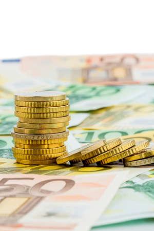 encogimiento: sola pila de monedas que mienten monedas de dinero s�mbolo de fotos para la inversi�n, el riesgo y los beneficios ca�da
