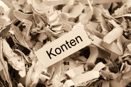 insider information: shredded paper tagged with accounts, symbol photo for finance, accounting and double-entry bookkeeping