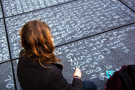 general knowledge: one student wrote an arithmetic problem on a pavement.