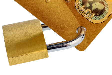 cashless: a golden credit card and padlock. symbolic photo for cashless purchases and status symbols. Stock Photo