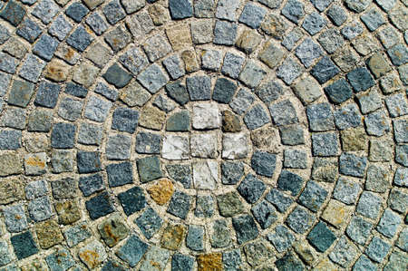 conformity: paving stones in a circular arrangement, symbol photo for order, conformity and group pressure