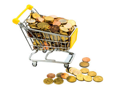 purchasing power: a shopping cart is well stocked with euro coins, symbolic photo for purchasing power and consumption Stock Photo