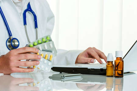physican: a doctor issues a prescription for medication. prescription tablets from the pharmacy. Stock Photo