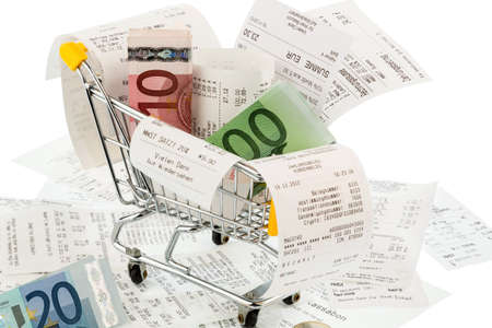 shopping cart, bills and receipts, symbol photo for purchasing power, consumption and inflation photo