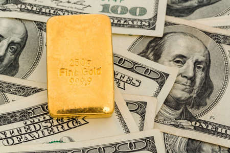 gold standard: gold bars on dollar bills, symbolic photo for gold reserves, exchange rates, investment, security