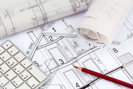 single familiy: an architects blueprint for the construction of a new residential house. symbolic photo for funding and planning of a new house. Stock Photo