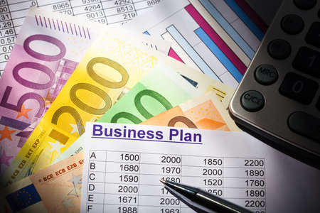 reestablishment: a business plan for starting a business. ideas and strategies for self-employment. euro banknotes and calculator