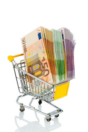 euro bank notes in a shopping cart icon photo for purchasing power, shopping, money printing and inflation photo