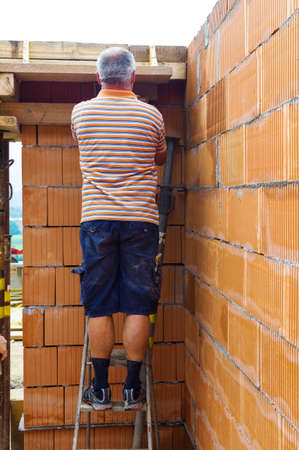 single familiy: a single-family house is built of brick solid construction