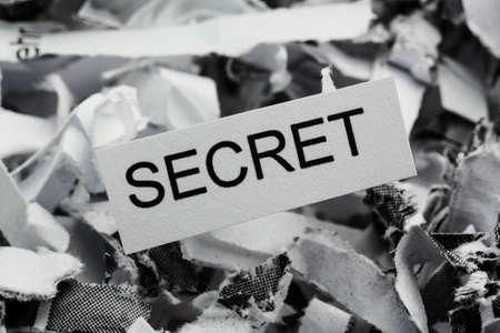 insider information: shredded paper tagged with secret, symbol photo for data destruction, banking secrecy and economic espionage