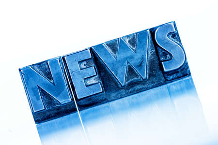 the word news written with lead letters. symbolic photo for newsletters, newspapers and information photo