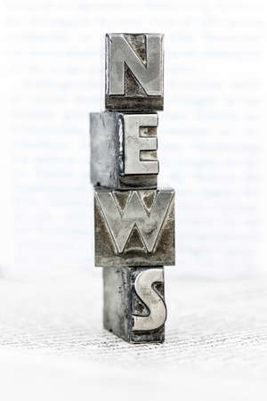 the word news written with lead letters an old printing press photo