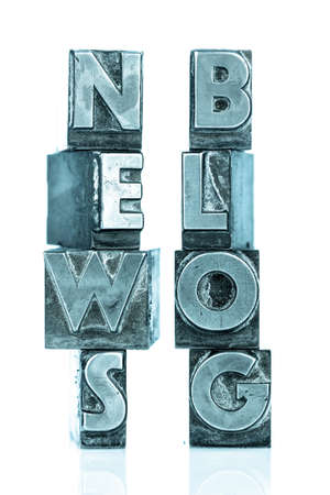 lead rope: the words news and blog written with lead letters an old printing press,