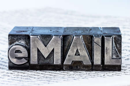 the word e-mail in lead letters written. symbolic photo for quick correspondence