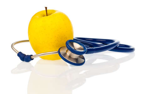 stethoskope: a stethoscope and an apple. symbolic of a healthy diet.
